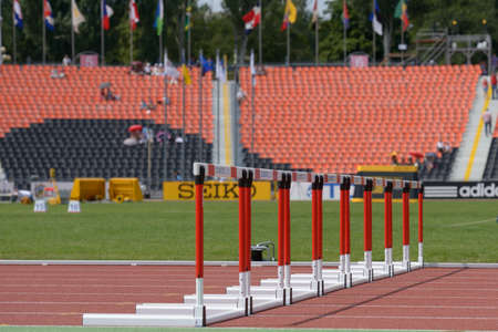 Donetsk, Ukraine - July 11, 2013: Row of hurdles on the track of stadium during 8th World Youth Championships in Donetsk, Ukraine on July 11, 2013
