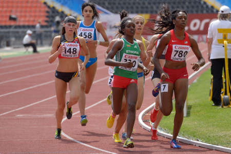 Donetsk, Ukraine - July 11, 2013: Girls compete in 800 m during 8th IAAF World Youth Championships in Donetsk, Ukraine on July 11, 2013. Left to right: Renee Eykens of Belgium, Eleonora Vandi of Italy, Kokeb Tesfaye of Ethiopia, Yuliya Moroz of Ukraine, R Editorial