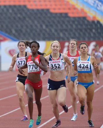 bri: Donetsk, Ukraine - July 11, 2013: Girls compete in 800 m during 8th IAAF World Youth Championships in Donetsk, Ukraine on July 11, 2013. Left to right: Tarryn Davey of New Zealand, Ersula Farrow of USA, Sanda Kocis of Croatia, Emily Jenkinson of Great Bri