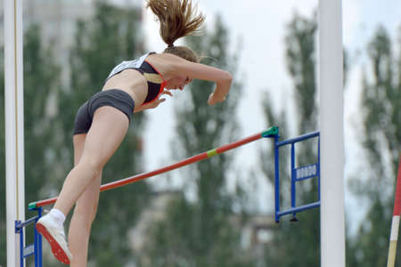 Donetsk, Ukraine - July 11, 2013: Ria Mollers of Germany competes in pole vault during 8th IAAF World Youth Championships in Donetsk, Ukraine on July 11, 2013