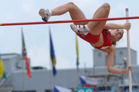 mckinley: Donetsk, Ukraine - July 11, 2013: Zoe McKinley of USA competes in Pole Vault during 8th IAAF World Youth Championships in Donetsk, Ukraine on July 11, 2013
