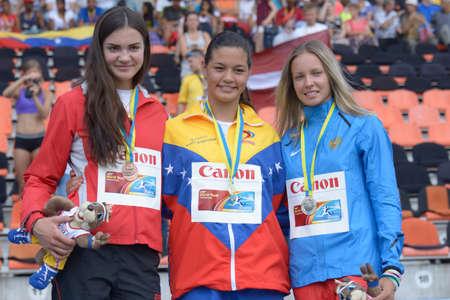latvia girls: Donetsk, Ukraine - July 14, 2013: Medalists in pole vault during 8th IAAF World Youth Championships in Donetsk, Ukraine on July 14, 2013. Left to right: Krista Obizajeva of Latvia, Robeilys Peinado of Venezuela, Alena Lutkovskaya of Russia Editorial