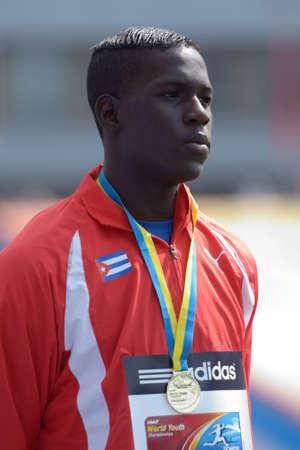 martinez: Donetsk, Ukraine - July 14, 2013: World Yough Champion in triple jump Lazaro Martinez of Cuba on medal ceremony during 8th IAAF World Youth Championships in Donetsk, Ukraine on July 14, 2013