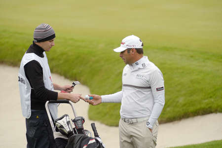 caddie: Moscow, Russia - July 27, 2013: Terry Pilkadaris of Australia with his caddie during 3rd round of the M2M Russian Open at Tseleevo Golf & Polo Club in Moscow, Russia on July 27, 2013