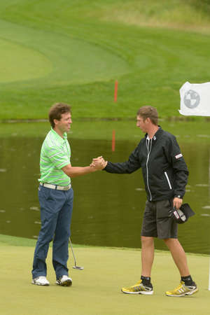 caddie: Moscow, Russia - July 27, 2013: Pablo Martin Benavides of Spain handshakes with his caddie during 3rd round of the M2M Russian Open at Tseleevo Golf & Polo Club in Moscow, Russia on July 27, 2013