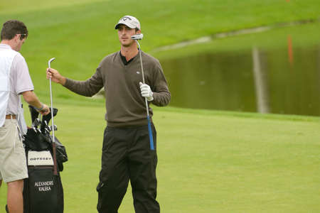 caddie: Moscow, Russia - July 27, 2013: Alexandre Kaleka of France with his caddie during 3rd round of the M2M Russian Open at Tseleevo Golf & Polo Club in Moscow, Russia on July 27, 2013