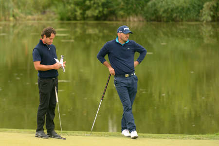 Moscow, Russia - July 28, 2013: Matteo Delpodio of Italy (left) and Gregory Havret of France during final round of the M2M Russian Open at Tseleevo Golf & Polo Club in Moscow, Russia on July 28, 2013