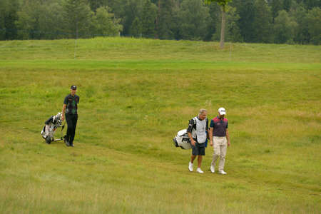 caddie: Moscow, Russia - July 28, 2013: Mark Foster of England (left) and Matthew Baldwin of England with his caddie during final round of the M2M Russian Open at Tseleevo Golf & Polo Club in Moscow, Russia on July 28, 2013