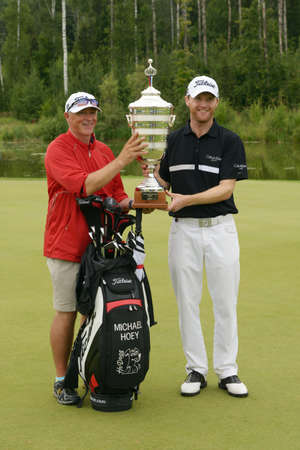 caddie: Moscow, Russia - July 28, 2013: Michael Hoey of Northern Ireland and his caddie celebrate with the trophy after winning the final round  of the M2M Russian Open at Tseleevo Golf & Polo Club in Moscow, Russia on July 28, 2013 Editorial
