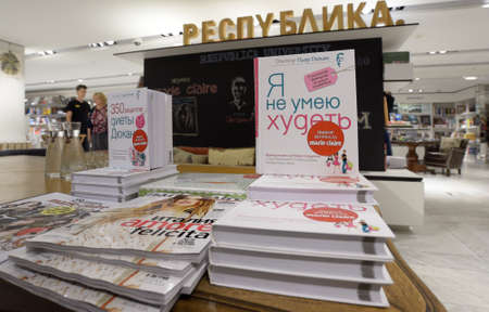 dietology: Moscow, Russia - July 30, 2013: Books of French dietitian Dr. Pierre Dukan during his meeting with readers of the magazine Marie Claire in Moscow, Russia on July 30, 2013