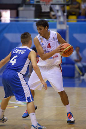 Kiev, Ukraine - August 8, 2013  Stefan Peno of Serbia and Arthur Leboeuf of France in action during the U16 Eurobasket 2013 First round match between France and Serbia at Palace of Sport in Kiev, Ukraine on August 8, 2013