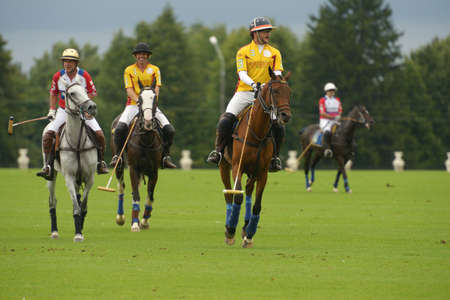 Moscow, Russia - July 27, 2013  Players between chukkers in the match between teams of Moscow Polo Club and Tseleevo Golf   Polo Club during 8th Russian Open Polo Championship in Tseleevo, Moscow, Russia on July 27, 2013