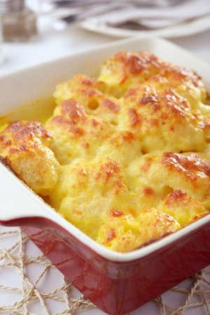 Cauliflower cheese in a baking dish photo