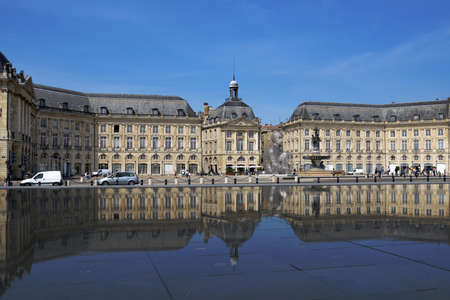 gironde:  Place de la Bourse reflected in the water mirror in Bordeaux, France on June 27, 2013. Opened in 2006, the pool is the largest water mirror in the world with 3450 sq. m.