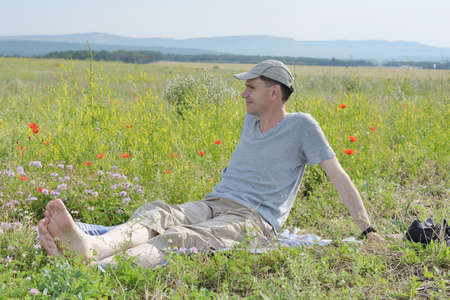 Man resting on a meadow photo
