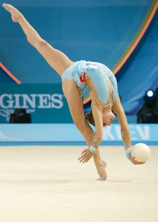 KIEV, UKRAINE - AUGUST 28, 2013:  Melitina Staniouta of Belarus in action during the 32nd Rhythmic Gymnastics World Championships in Kiev, Ukraine on August 28, 2013