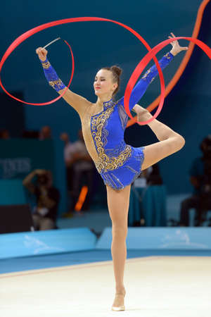 KIEV, UKRAINE - AUGUST 29, 2013: Ganna Rizatdinova of Ukraine in action during the 32nd Rhythmic Gymnastics World Championships in Kiev, Ukraine on August 29, 2013