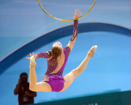 KIEV, UKRAINE - AUGUST 28, 2013: Alina Maksymenko of Ukraine in action during the 32nd Rhythmic Gymnastics World Championships in Kiev, Ukraine on August 28, 2013