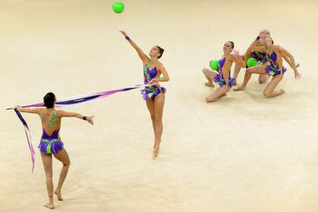 KIEV, UKRAINE - SEPTEMBER 1: Team Spain performs the routing with balls and ribbons during the 32nd Rhythmic Gymnastics World Championships in Kiev, Ukraine on September 1, 2013