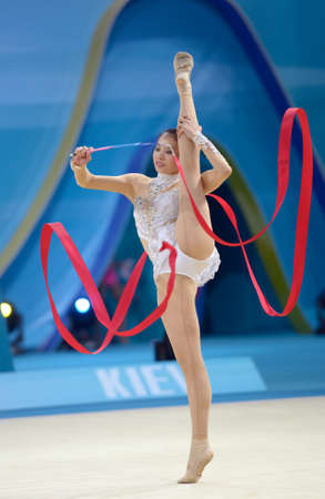 deng: KIEV, UKRAINE - AUGUST 30, 2013:  Senyue Deng of China in action during the 32nd Rhythmic Gymnastics World Championships in Kiev, Ukraine on August 30, 2013