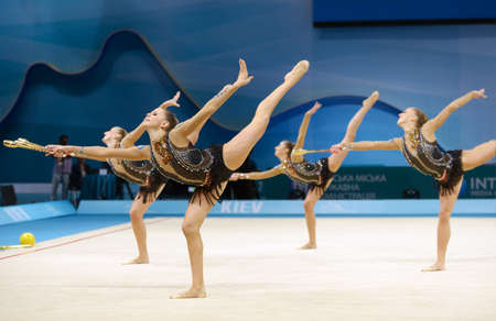 KIEV, UKRAINE - AUGUST 31, 2013: Team Italy performs the routing with clubs during the 32nd Rhythmic Gymnastics World Championships in Kiev, Ukraine on August 31, 2013