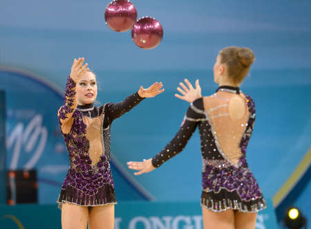 KIEV, UKRAINE - AUGUST 31, 2013: Team Switzerland performs the routing with balls and ribbons during the 32nd Rhythmic Gymnastics World Championships in Kiev, Ukraine on August 31, 2013