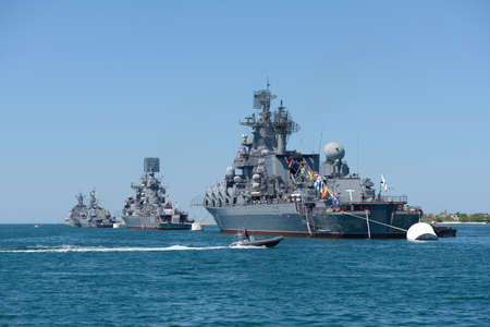 Sevastopol, Ukraine - May 8, 2013: Russian and Ukrainian warships anchored in the bay of Sevastopol, Crimea, Ukraine on May 8, 2013. Ships prepare to the naval parade in honor of 230th anniversary of Black Sea Navy