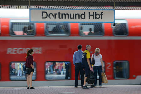 billions: Dortmund, Germany - September 7, 2013: People on the platform during the arrival of the commuter train on the station of Dortmund, Germany on September 7, 2013. About 2 billions passengers are carried by DeutscheBahn annually