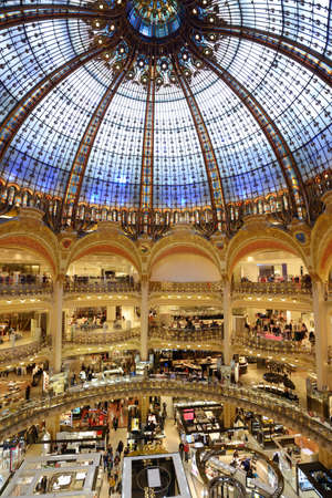 les: Paris, France - September 13, 2013: Interior of  Les Galeries Lafayette store in Paris, France on September 13, 2013. Opened in October 1912, the store receives about 100,000 visitors a day