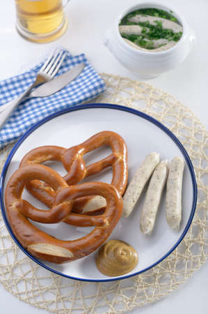 Bavarian sausages with pretzels and mustard photo
