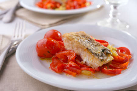 cod: Baked cod with vegetables on a plate Stock Photo