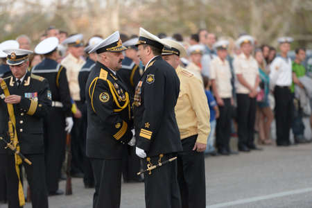 handshakes: Sevastopol, Ukraine - May 7, 2013: Vice admirals Alexander Fedotenkov, Russia, right and Youry Ilyin, Ukraine, handshakes on the rehearsal of military parade in honor of Victory Day in Sevastopol, Crimea, Ukraine on May 7, 2013 Editorial