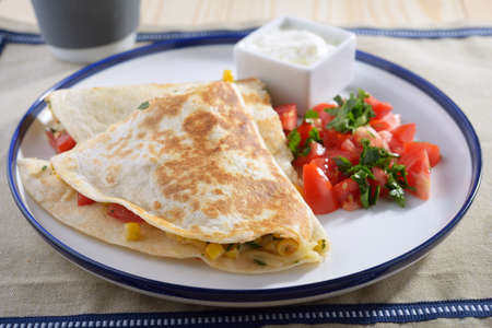 Quesadilla with vegetables on a plate photo
