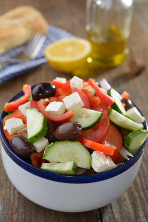 Greek salad on a rustic table photo