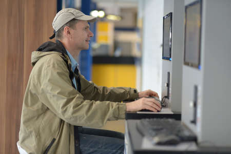 access point: Man using public internet access point in airport Stock Photo