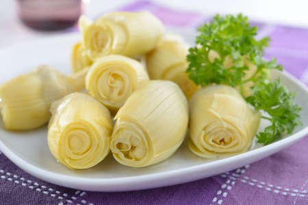 Marinated artichokes with parsley on a plate