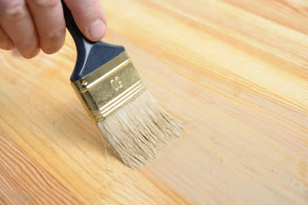 wood stain: Painting the wooden plank with wood stain