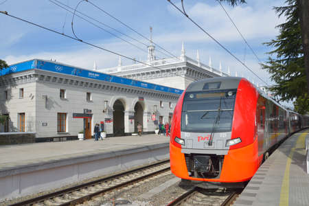 Sochi, Russia - February 14, 2014: Lastochka high-speed train on the railway station of Sochi. Russian Railways provide free passenger transport on suburban commuter trains in the Sochi area during the Winter Olympics