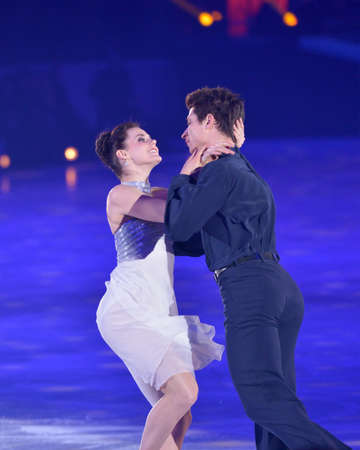 virtue: Moscow, Russia - February 24, 2014: Tessa Virtue and Scott Moir in action during Gala concert of Olympic champions in figure skating in Luzhniki Editorial