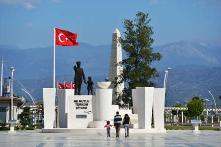 esteemed: Fethiye, Turkey - April 1, 2014  People go toward the monument to Ataturk  The founder of Republic of Turkey still is esteemed in the country today