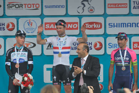 ariel: Marmaris, Turkey - April 30, 2014: Award ceremony of 4th stage of 50th Presidential Cycling Tour of Turkey. Winners left to right: Mark Renshaw, Mark Cavendish, Ariel Maximiliano Richeze Araquistain
