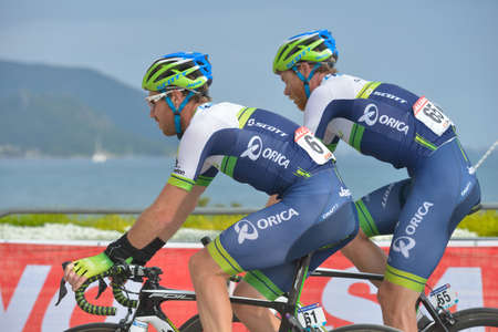 docker: Marmaris, Turkey - April 30, 2014: Mitchell Docker (left) and Jens Mouris from Orica - GreenEDGE team on the finish of 4th stage of 50th Presidential Cycling Tour of Turkey Editorial