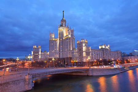 kotelnicheskaya embankment: Moscow, Russia - March 11, 2014  Building on Kotelnicheskaya embankment in evening  Completed in 1952, the main tower has 32 levels and is 176 metres  577 ft  tall