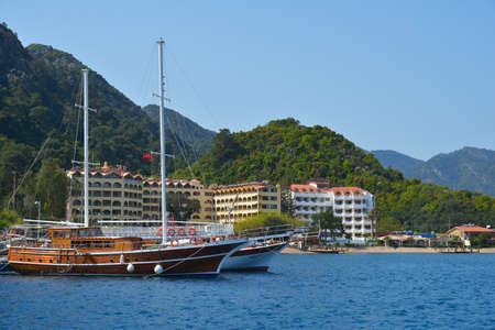 quieter: Icmeler, Mugla province, Turkey - April 2, 2014  Yachts against the hotels and mountains  The resort is targeted to tourists seeking a quieter alternative to the overdeveloped Marmaris Editorial