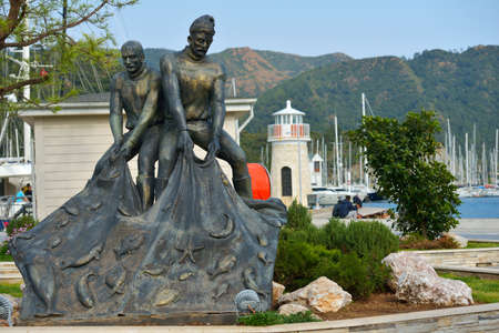 Marmaris, Turkey - April 2, 2014  Monument to fishermen on the embankment  The monument reminds that few decades ago the modern resort was a sleepy fishing village