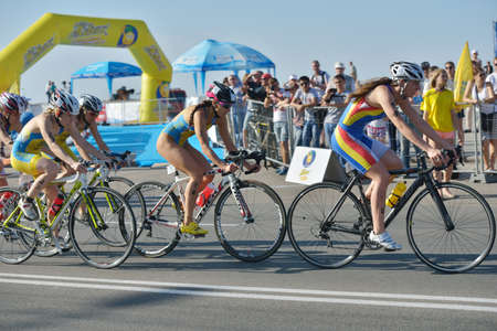 Dnepropetrovsk, Ukraine - May 24, 2014: Female athletes race on the cycling stage of ETU Sprint Triathlon European cup. Its the first time Triathlon European Cup take place in Ukraine