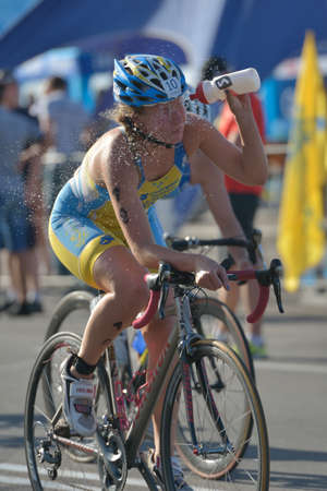 Dnepropetrovsk, Ukraine - May 24, 2014: Roksolana Ishchuk of Ukraine races in the cycling stage of ETU Sprint Triathlon European cup. Its the first time Triathlon European Cup take place in Ukraine