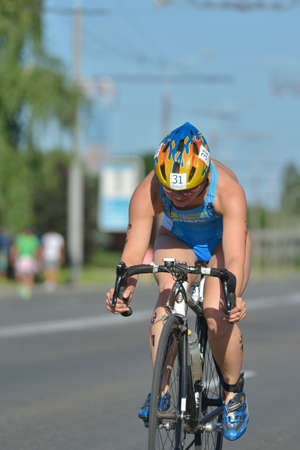 Dnepropetrovsk, Ukraine - May 24, 2014: Olena Susol of Ukraine races in the cycling stage of ETU Sprint Triathlon European cup. Its the first time Triathlon European Cup take place in Ukraine