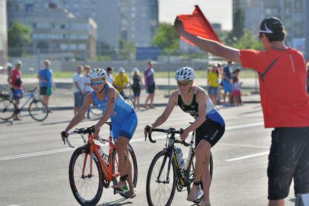 Dnepropetrovsk, Ukraine - May 24, 2014: Yuliya Yelistratova of Ukraine (left) and Mateja Simic of Slovenia finish the cycling stage of ETU Sprint Triathlon European cup. Its the first time Triathlon European Cup take place in Ukraine