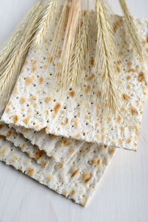 jewish cuisine: Matzo and ears on a wooden table